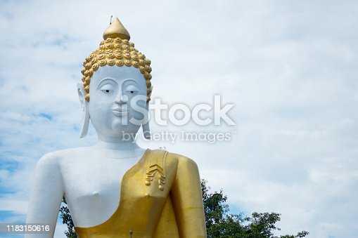 Buddha statue in Phra That Doi Kham temple at Chiang Mai, Northern Thailand