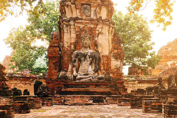 Buddha statue in the ruined ancient temple stock photo
