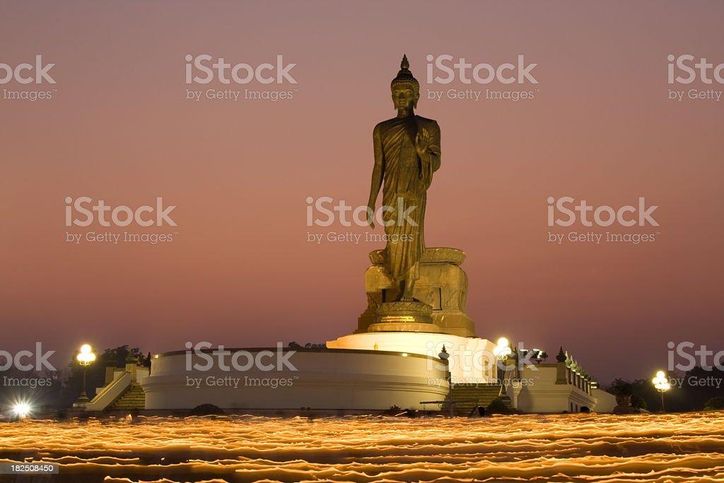 Buddha statue on lighting candle stock photo