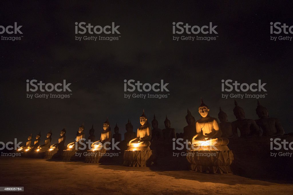 Buddha statue on night stock photo