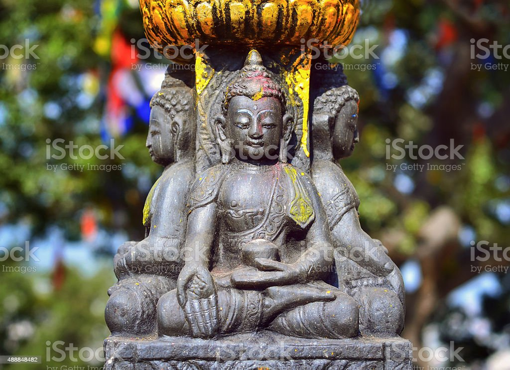 Buddha statue   on the square near Swayambhunath stupa stock photo