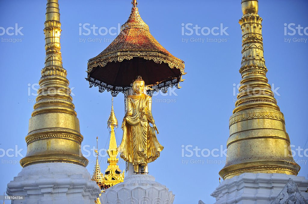 Buddha statue on top of pagoda around Shwedagon royalty-free stock photo