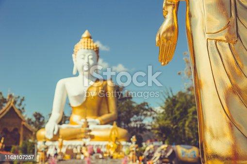 Buddha statue outdoor in Thai temple vintage color tone travel landmark in Doi kham Chiangmai
