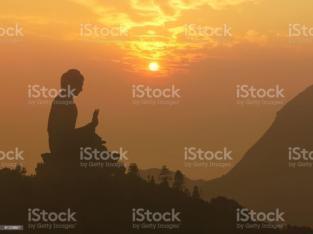 Buddha statue silhouette at sunset stock photo
