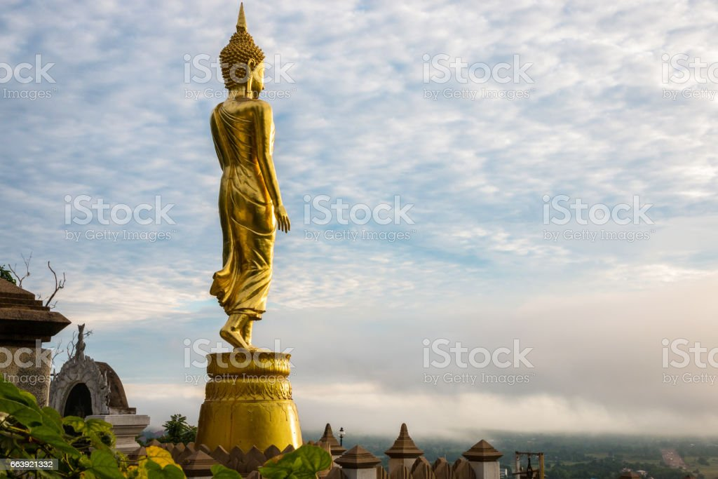 Buddha statue standing at Wat Phra That Khao Noi, Nan, stock photo