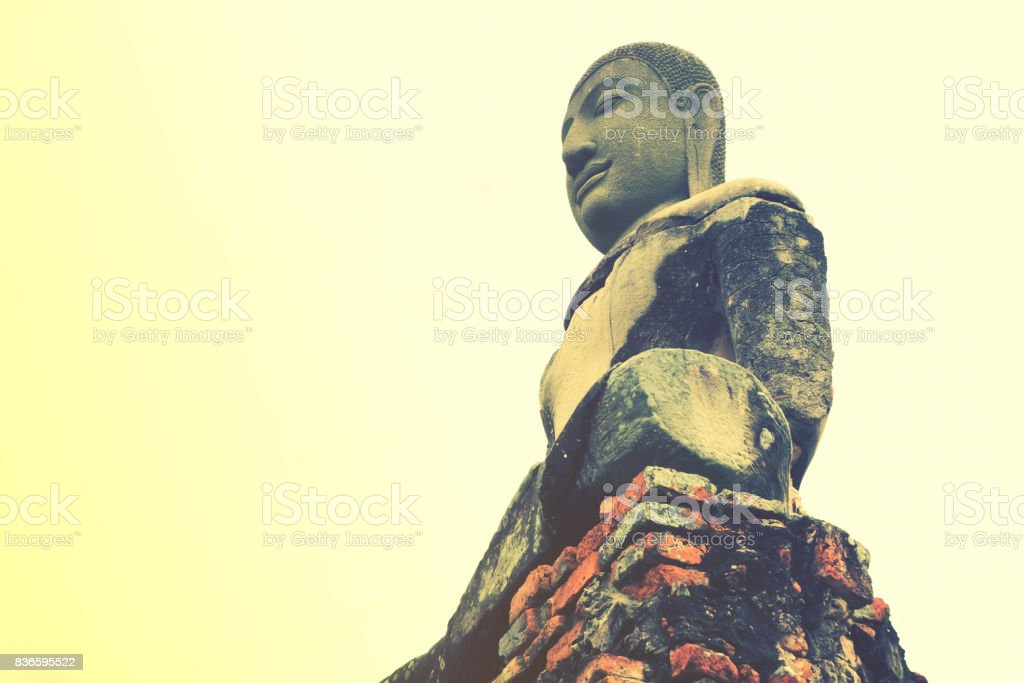 Buddha Statue with Beautiful Blue Sky at Ayutthaya Historical Park, Ancient monk Image of religion representative of people belief stock photo
