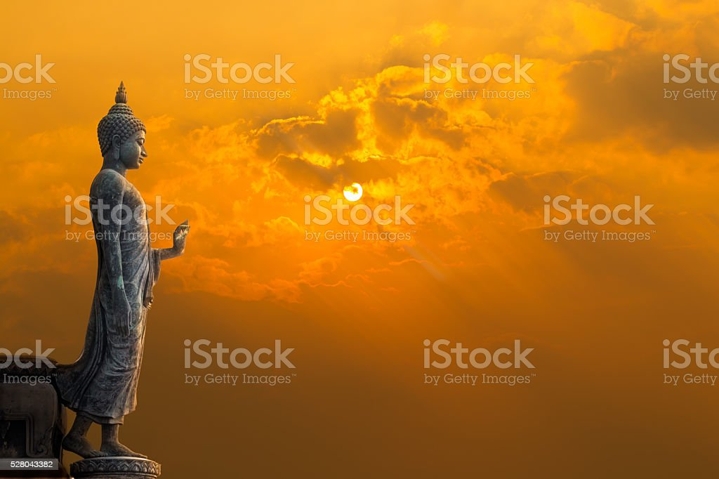 Buddha statue with sun stock photo