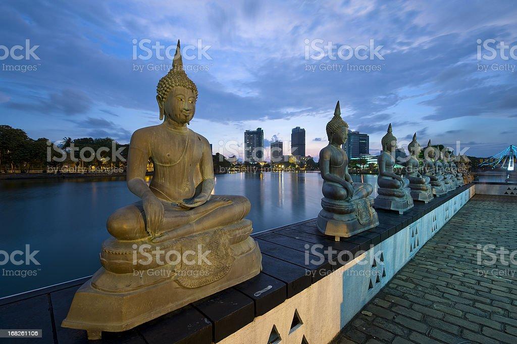 Buddha statues at night stock photo