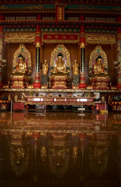 buddha statues in a buddhist temple, in Sandakan , Sabah, Malaysian Borneo stock photo