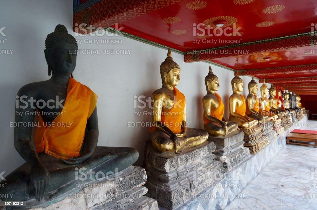 Buddha statues in line at Wat Arun temple in Bangkok stock photo