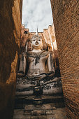 Buddha statues in temple ruins in Sukhothai, Thailand
