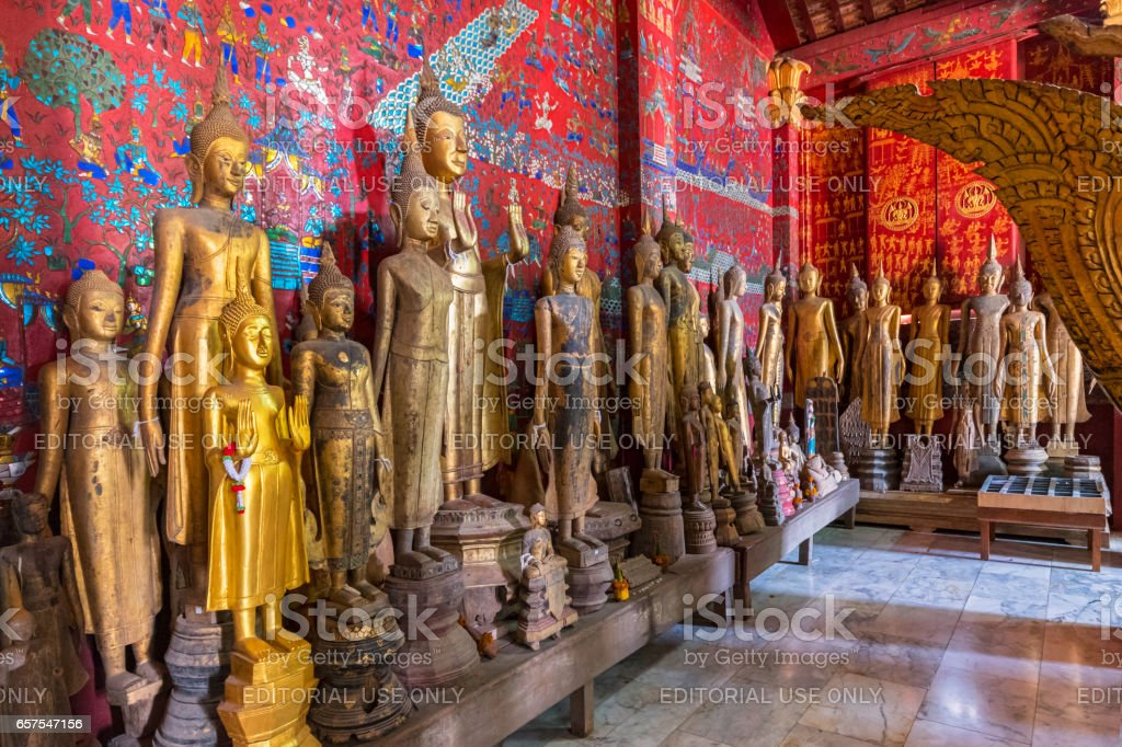 Buddha statues in the Funerary Carriage Hall, Wat Xieng Thong, Luang Prabang, Laos, Indochina, Asia stock photo