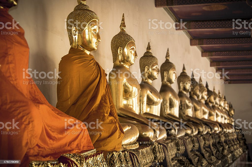 Buddha statues ina  row at Wat Arun in Bangkok, Thailand. stock photo