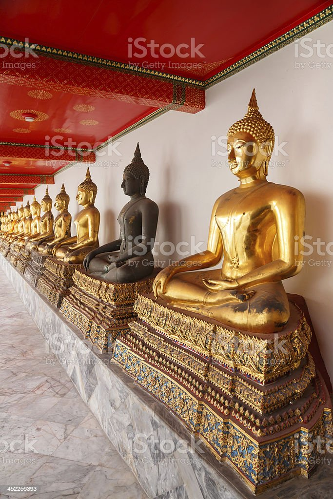 Buddha statues made of metal and black brass royalty-free stock photo