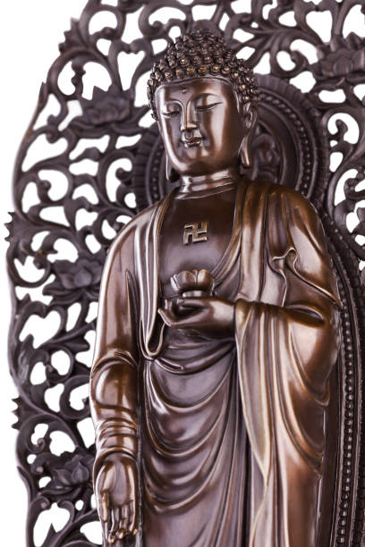 Buddha with a lotus and a swastika. Figure of the standing Buddha with a lotus in a hand and a swastika on a breast. bodhisattva stock pictures, royalty-free photos & images