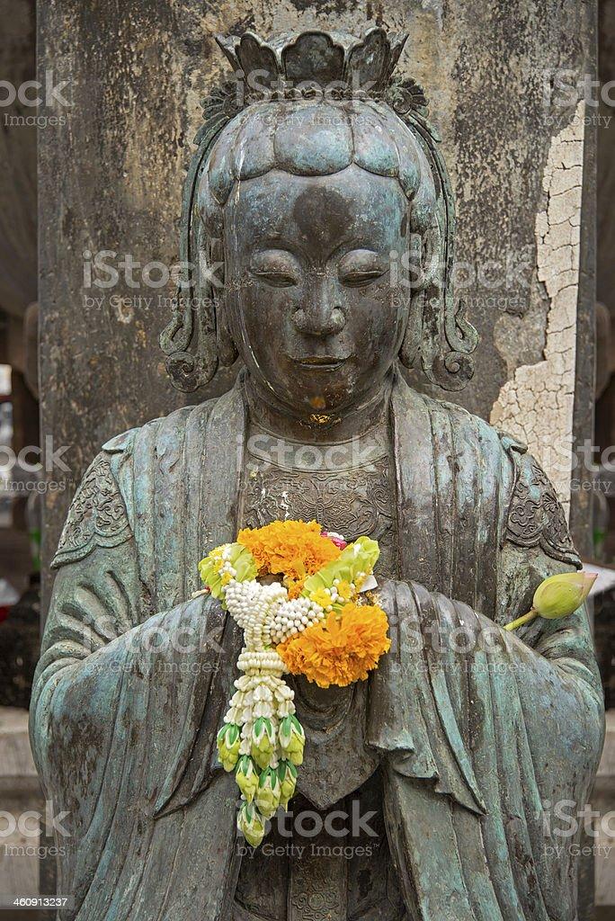 Buddha with Marigolds royalty-free stock photo