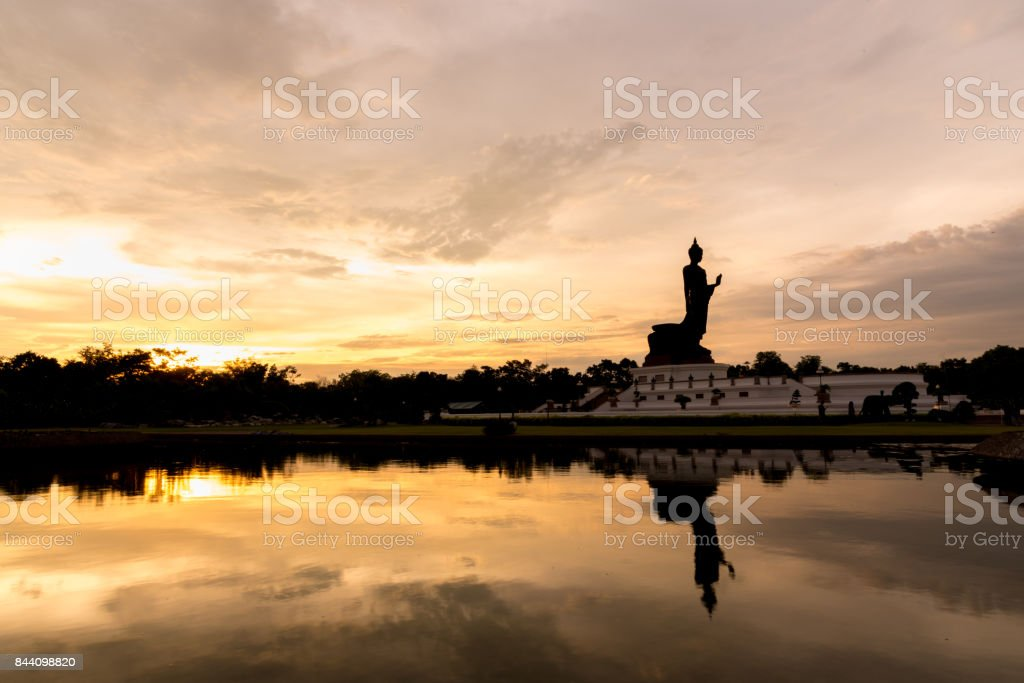 Buddhamonthon is place for Buddhist Dharma with orange and yellow sky and sunset. stock photo