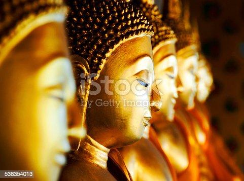 Row of Buddhas at Wat Arun, Bangkok, Thailand.