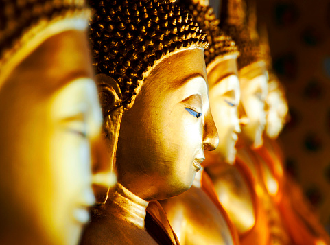 Row of Buddhas at Wat Arun, Bangkok, Thailand.
