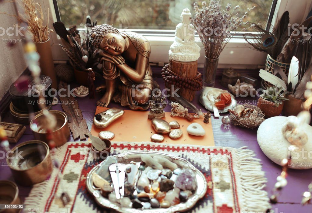 Buddha's home altar with stones and offerings stock photo
