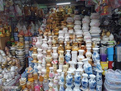 Danang, Vietnam  - August 23, 2019 : Buddhism spirit objects for sale on Danang street