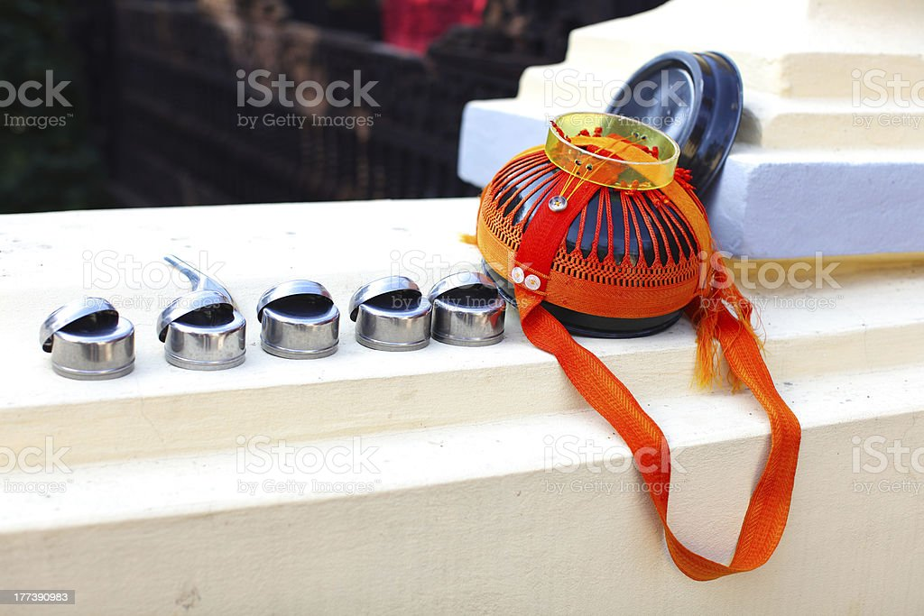 Buddhist alms bowl with rice cups royalty-free stock photo