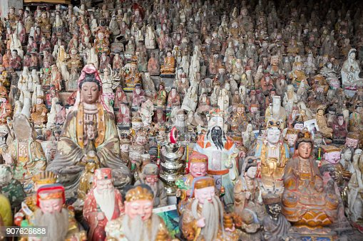 Buddhist and Taoism statue Large group of objects background