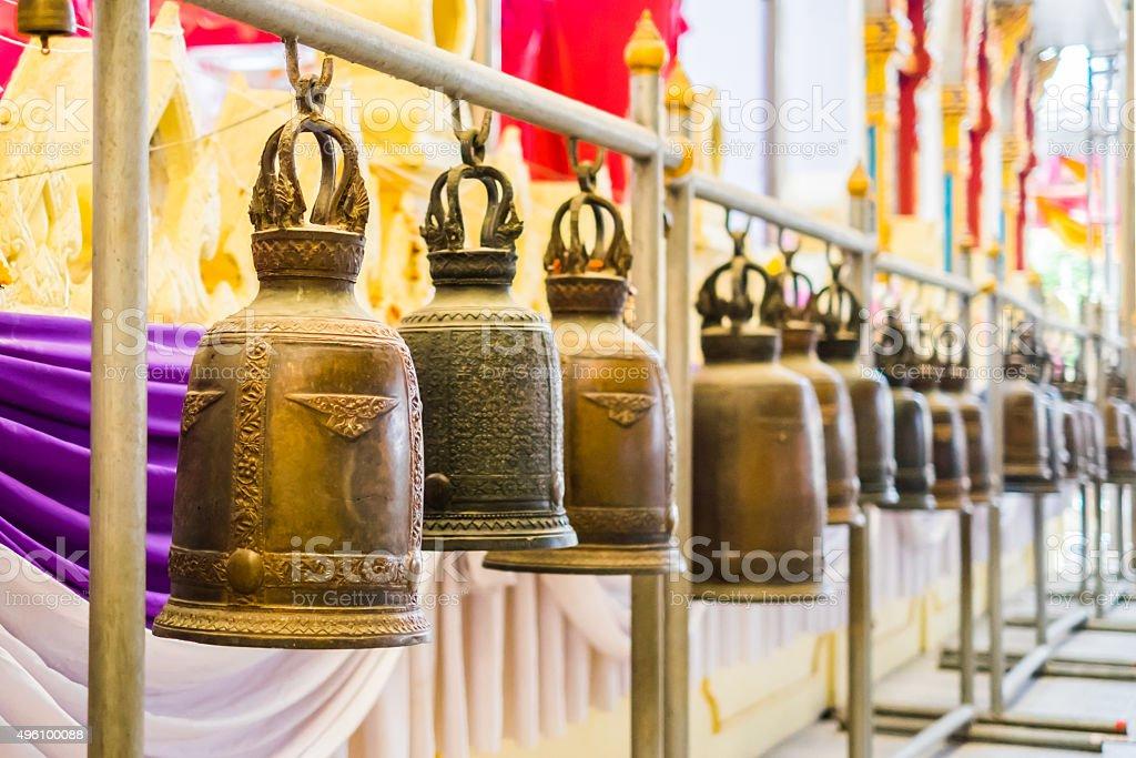 Buddhist brass bells in Wat Rai Khing stock photo