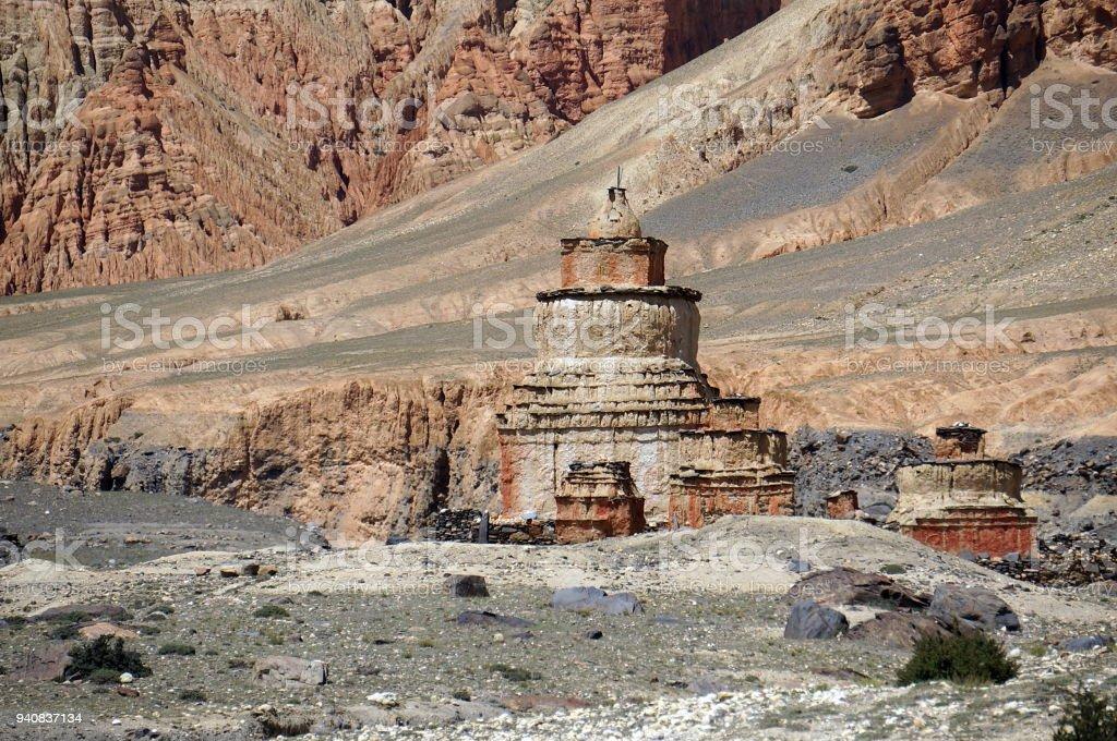 Buddhist  chorten against in the red cliffs of Drakmar. stock photo