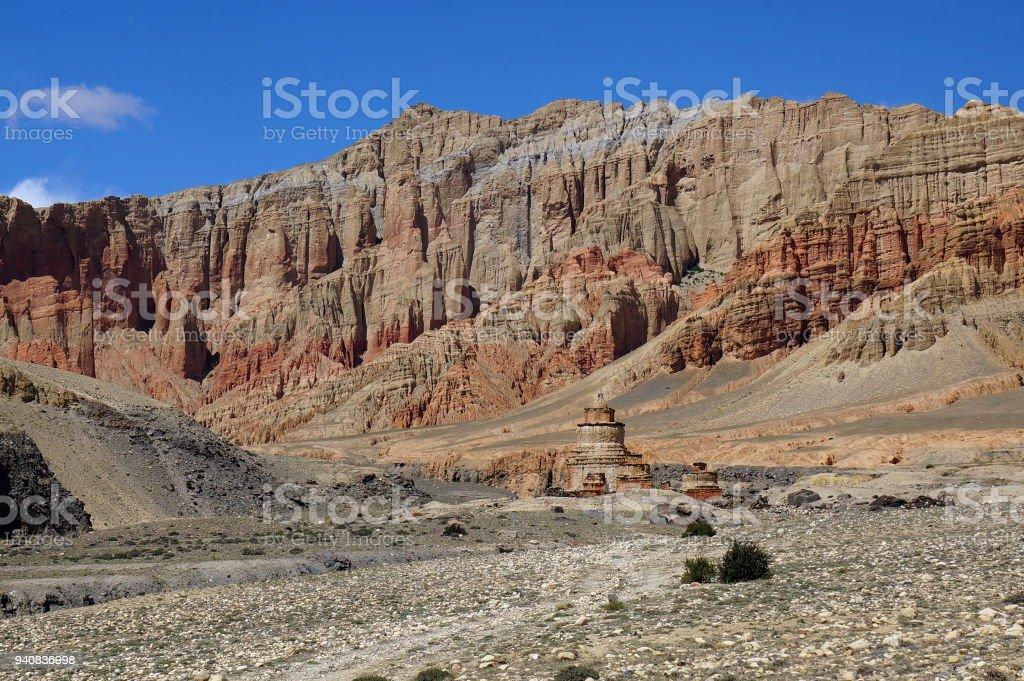 Buddhist  chorten against the background of red cliffs of Drakmar. stock photo