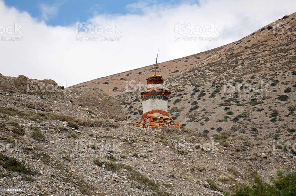 Buddhist Chorten for protection from evil spirits stand on a hill. stock photo