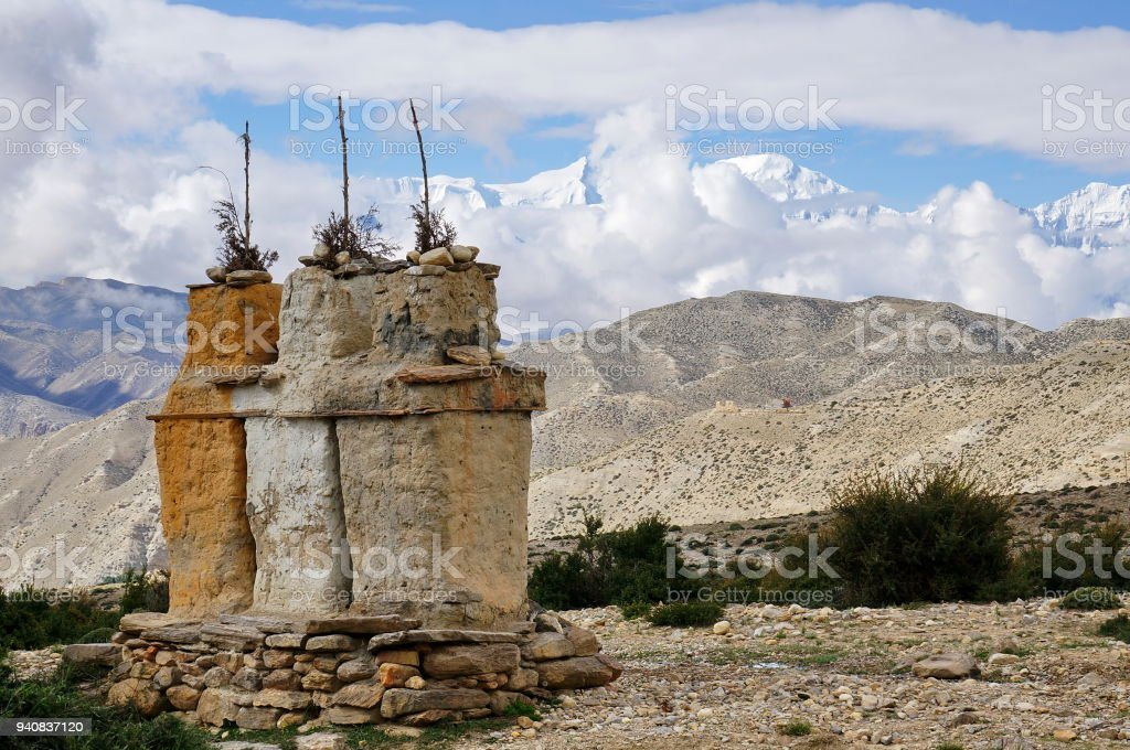 Buddhist chortens against the background of the Annapurna snow massif in the Himalayan mountains. stock photo