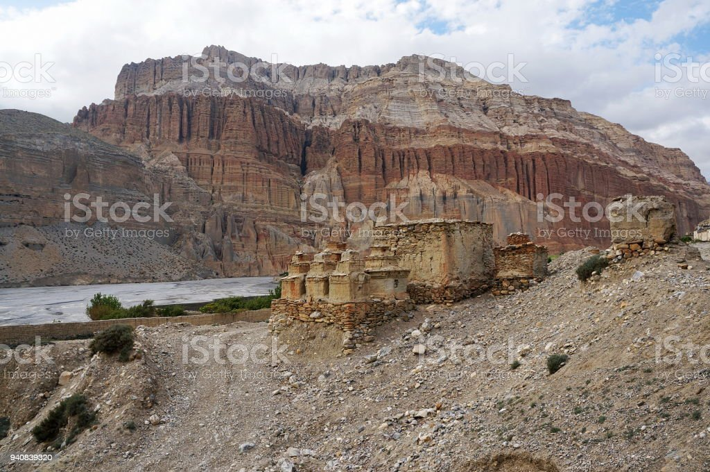 Buddhist chortens and ruins against the background of mountains, on the way to Chusang. stock photo