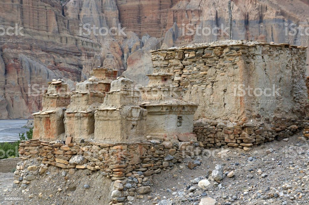 Buddhist chortens and ruins on the way to Chusang. stock photo