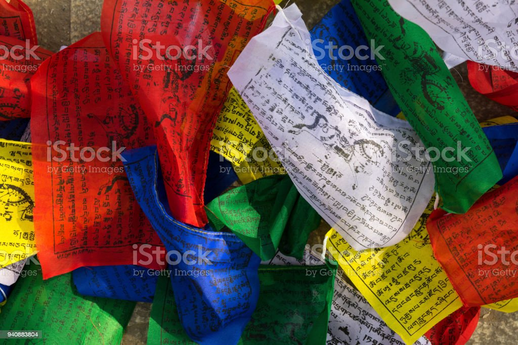 Buddhist colorful prayer flags with printed mantras. Religion symbols stock photo