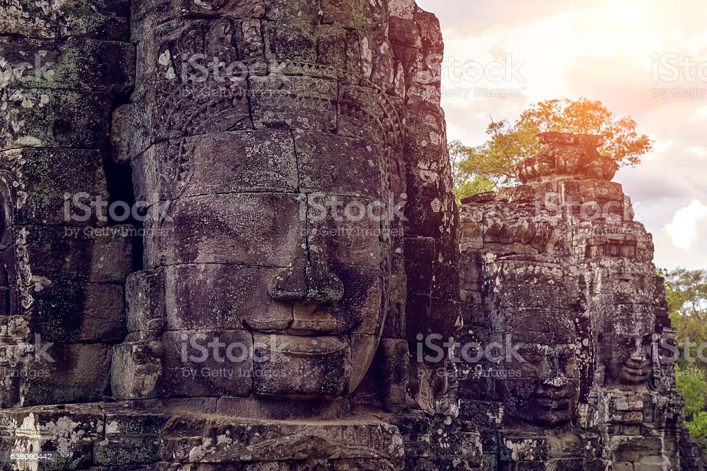 Buddhist faces Bayon Temple, Angkor wat in Cambodia. stock photo