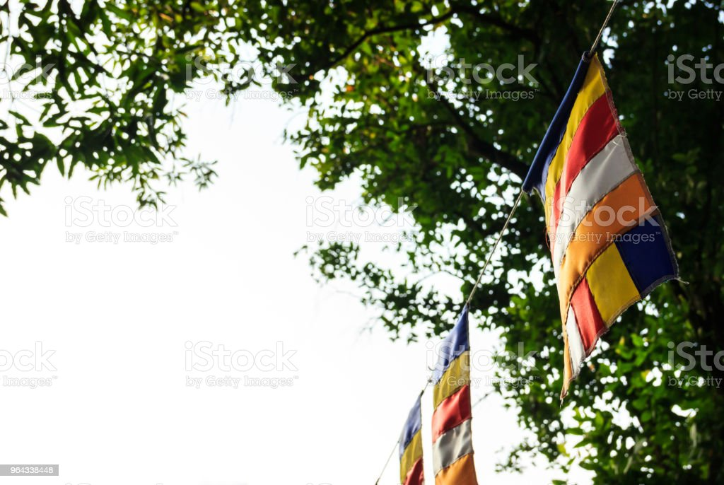 Buddhist flags in Buddhist temple with copy space. Symbol of Worship, Belief, Cultural Religious concept. stock photo