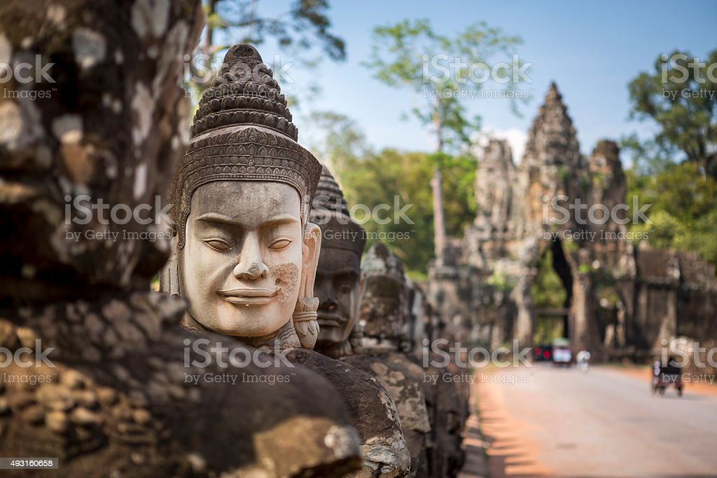 Buddhist head statue in Angkor Wat temple site stock photo