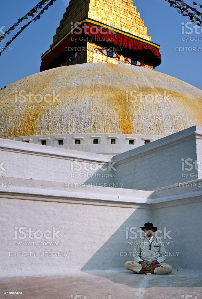 Buddhist in a bottom of Bodhanath stupa royalty-free stock photo