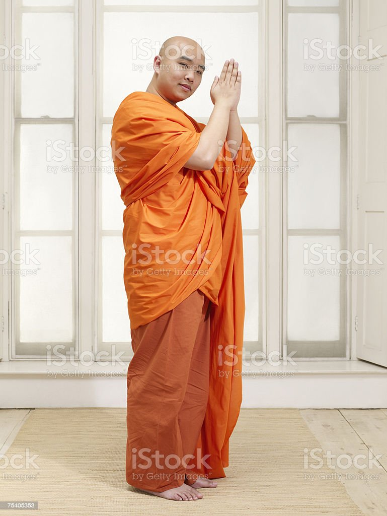 Buddhist man praying foto de stock royalty-free