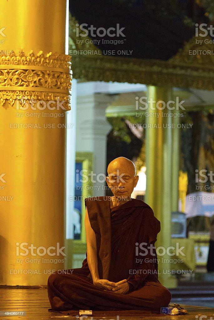 Buddhist monk at the Shwedagon Pagoda stock photo