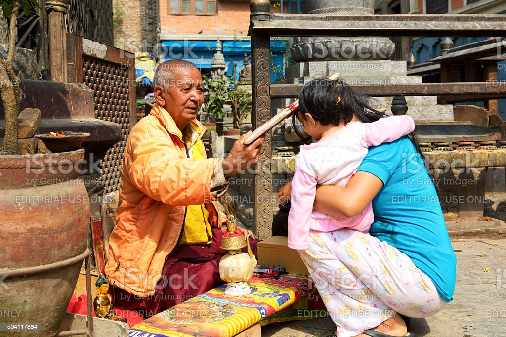 Buddhist monk blessing people stock photo