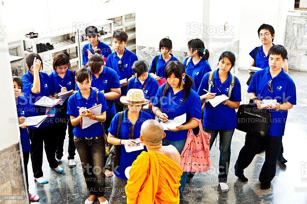 buddhist monk explains the secrets of temple area stock photo