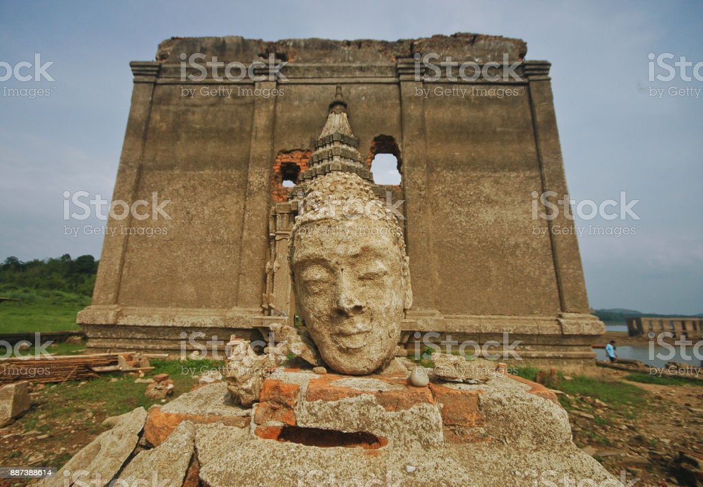 Buddhist monk head arts in front of underwater temple in Thailand stock photo