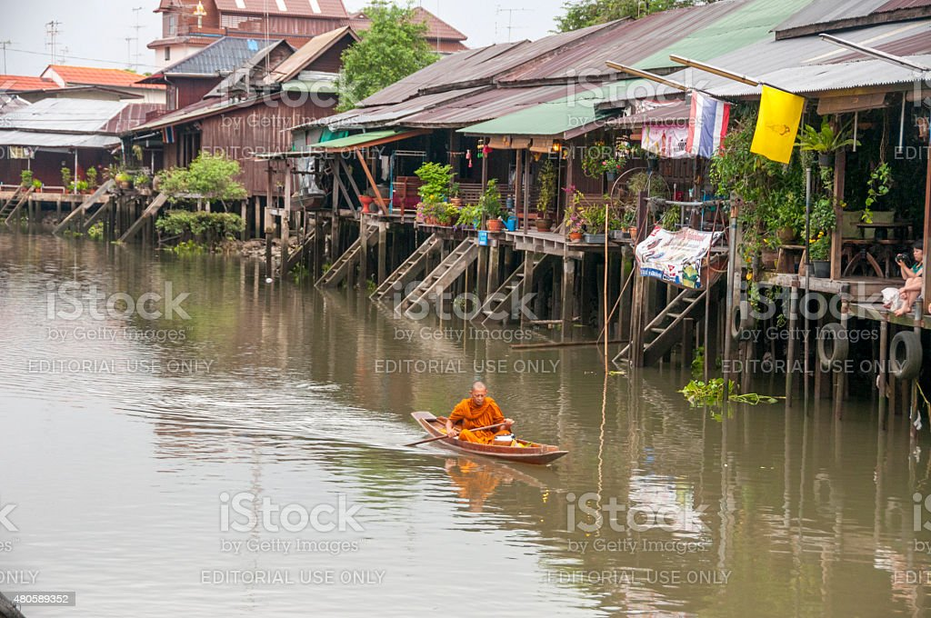 Buddhist Monk In A Boat stock photo