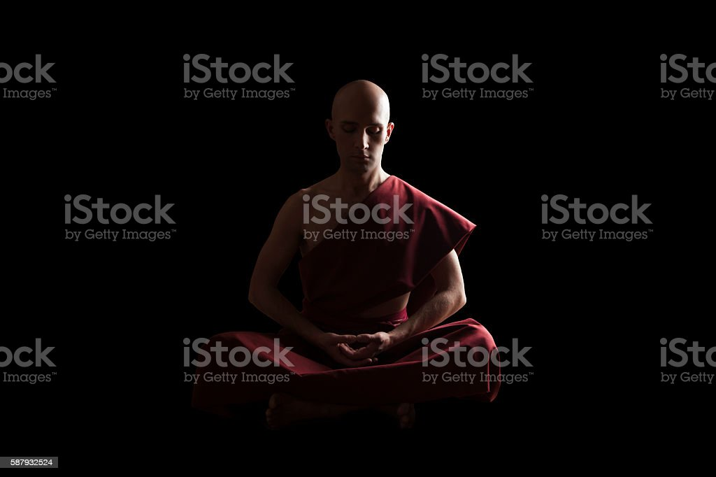 Buddhist Monk In Meditation Pose Over Black Background Royalty Free Stock Photo