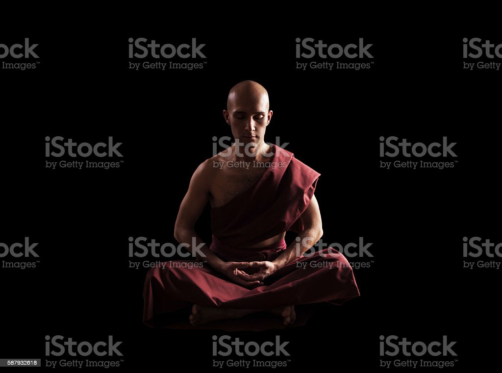buddhist monk in meditation pose over black background - foto de stock