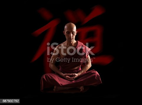 Buddhist Monk In Meditation Pose Over Black Background Stock Photo More Pictures Of Art