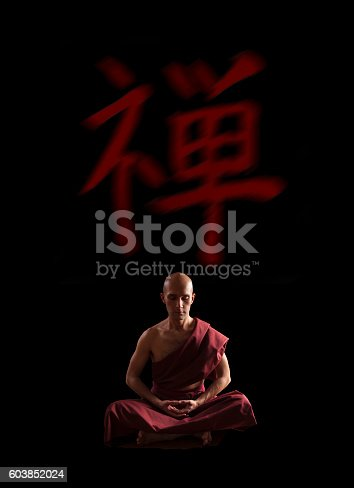Buddhist Monk In Meditation Pose Over Black Background Stock Photo 603852024
