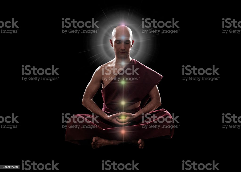 buddhist monk in meditation  pose with colorful Chakras stock photo